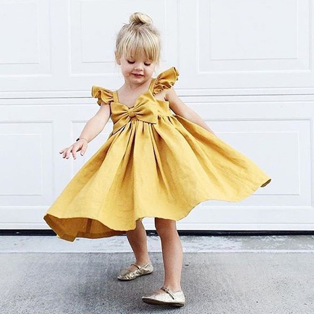 2018 New Pure Color Beach Girl Dress Bow Tie Princess Dress Yellow Pink Infant Cute Summer Clothes Baby Flying Sleeves Dress