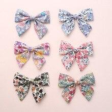 12 sztuk/partia, dziewczynek kwiatowy print Sailor Bow spinki do włosów, materiał w kwiaty łuk nylonowe opaski, szkoła kokardka dla dziewczynek akcesoria do włosów