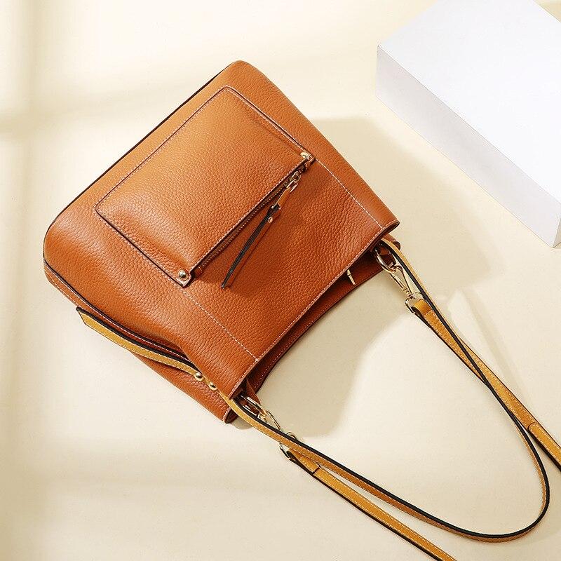 Nueva bolsa de mensajero de cuero vertical tipo cuadrado portátil Europa y los Estados Unidos Cubo de lichi de cuero de moda - 5