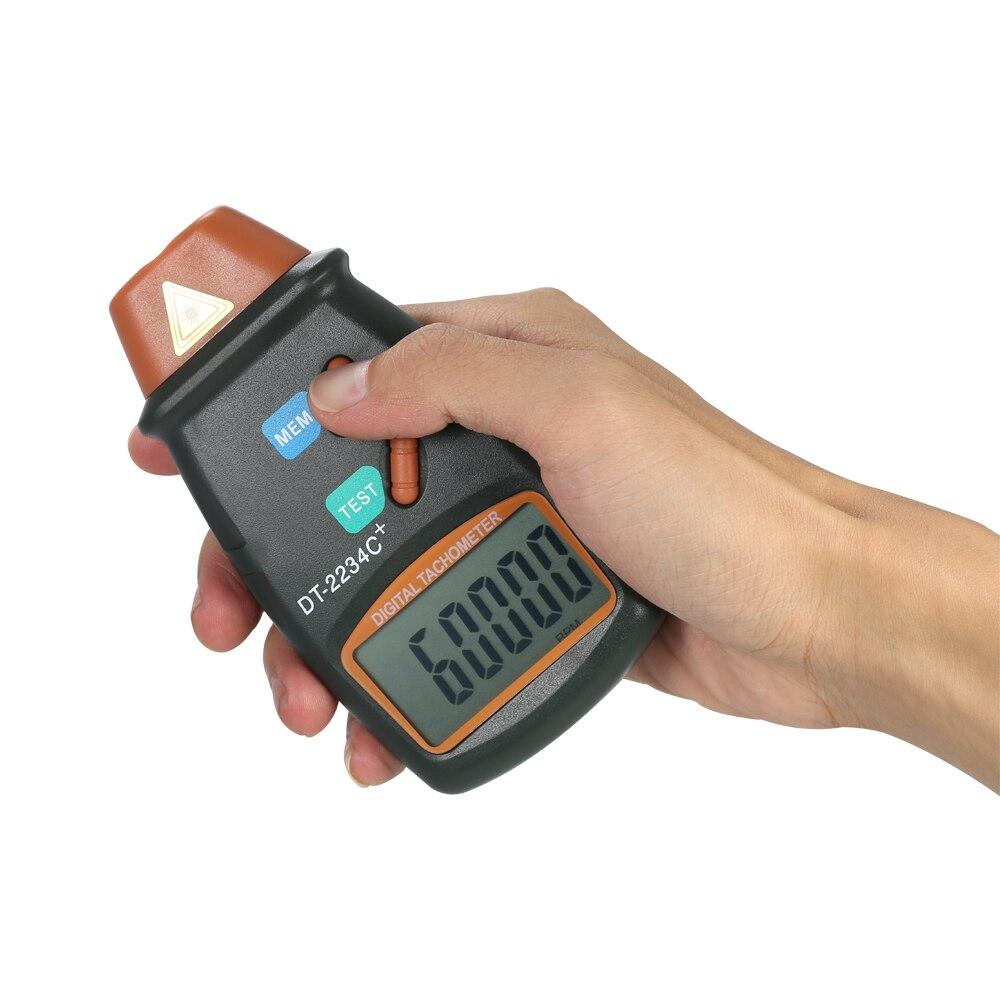 Handheld Digital Photo Tacômetro LCD Medidor de Velocidade Do Motor A Laser  Faixa de Não Contato Tacômetro 2.5 RPM 99,999 RPM com 3 pcs Fita Reflexiva  em ... 6e5a16496d