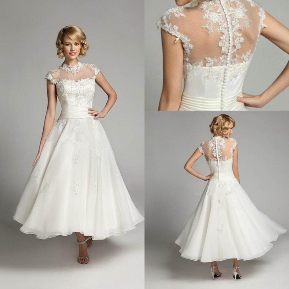 bridal wear t length wedding dresses hn veronica Brocade tea length wedding dress with subtle bow and elegant cut