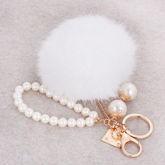 Onnea Faux Rabbit Fur Ball PomPom Fluffy Pearl Keychain Women Bag Charm  Trinket Gold Plated Key Ring Chain Men Car Jewelry 1532c3f6a1e94