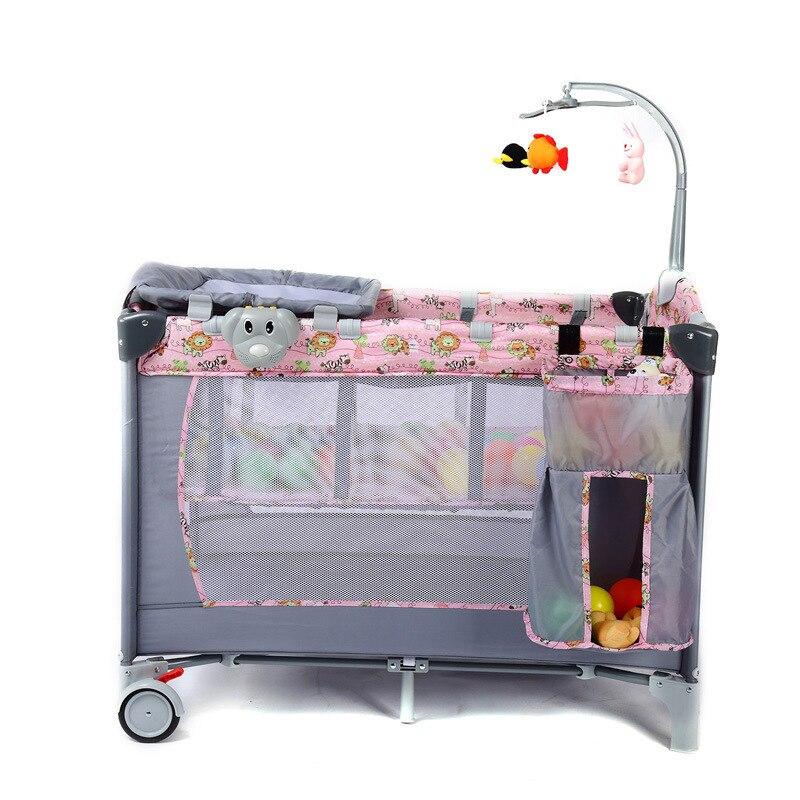 Multi-fonction avec rouleau et ceinture de sécurité bébé berceau jeu lit pliant Portable Double couche voyage lit enfants aire de jeux