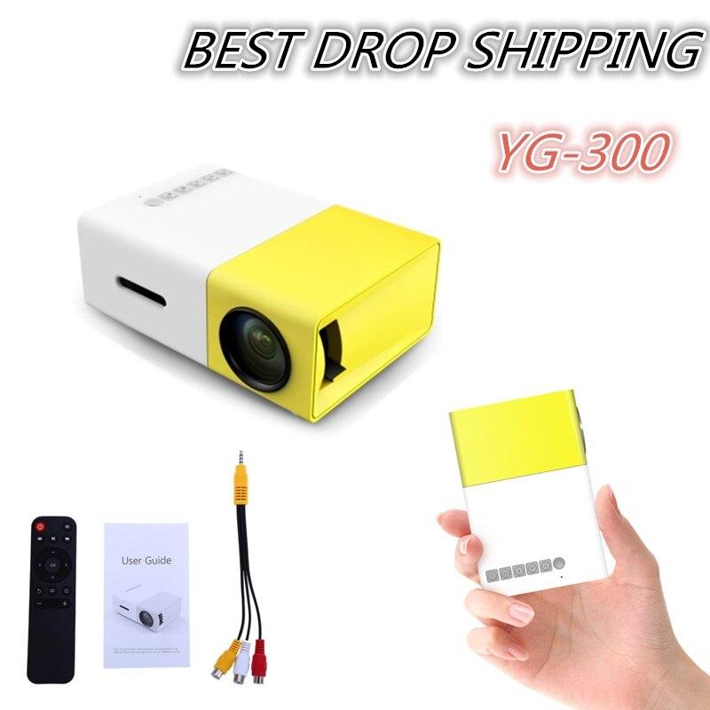 Trasporto di goccia YG300 YG310 Proiettore Portatile A LED 400-600LM Audio 320x240 Pixel YG-300 HDMI USB Mini Proiettore Multimediale di Casa lettore