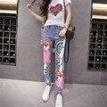 2016 europa de la manera del arco iris patrón de lentejuelas jeans mujer pantalones vaqueros del agujero rasgado jean boyfriend jeans para mujeres flare
