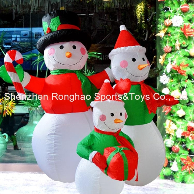 4 inflatable snowman family led lighted outdoor christmas yard art decoration holding gifts - Led Lighted Outdoor Christmas Decorations