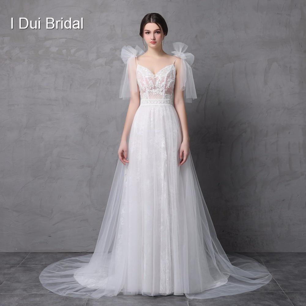 Nytt Stil Verkligt Foto Bröllopsklänning Spaghetti Bow Tie Strap En Line Tulle Utsökt Blond Romantiskt Unikt Design Split Leg