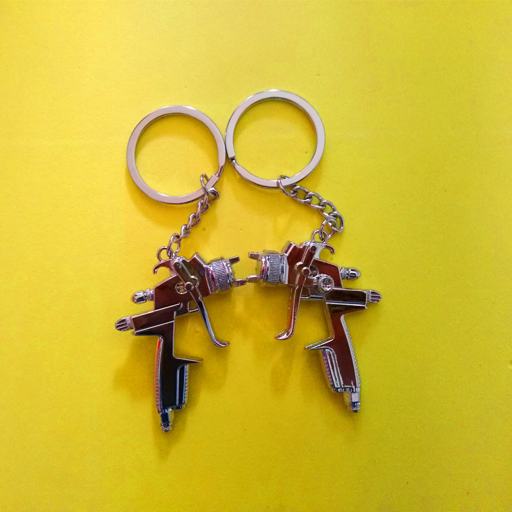 100Pcs High quality creative new water gun keychain men s and women s zinc alloy key