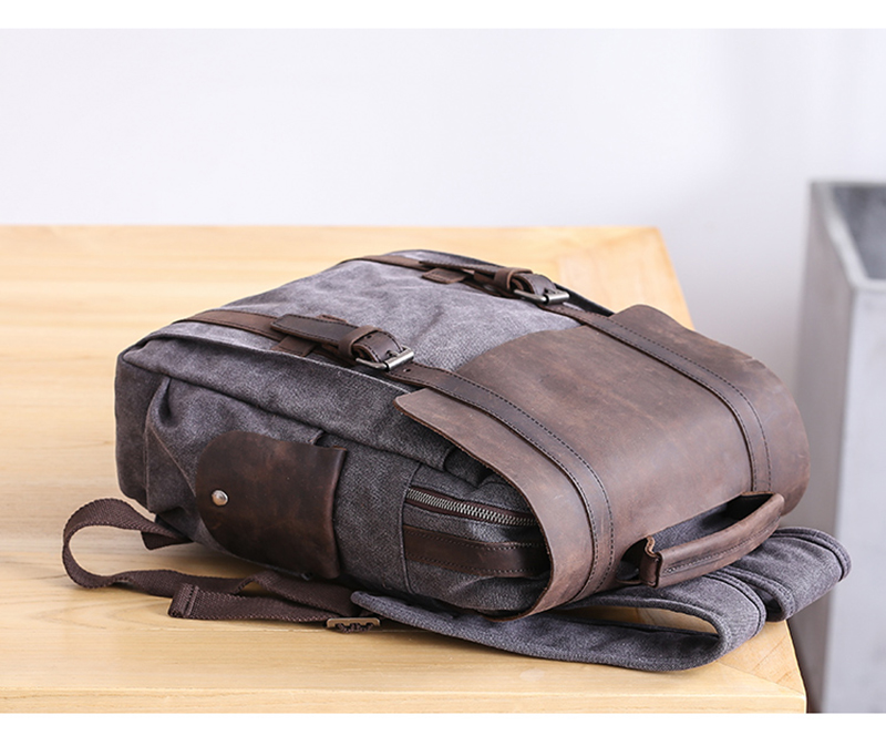 black Manitoba Small Canvas rucksack on a table