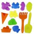 12 unids niños playa niños play novedad juguete molde de arena juguete de la playa pala-color al azar