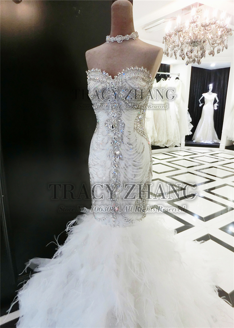 beautiful rhinestone crystal sequin beaded swarovski wedding dresses rhinestone wedding dress Swarovski wedding dresses is famous its shining rhinestones and glass diamonds Swarovski wedding dresses also embellished with lots of sequins and beads