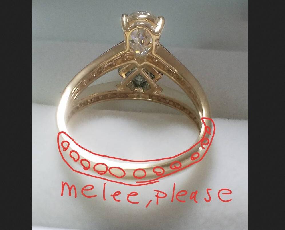 1.5ct lab ruby pear shape  0.5ct white princess cut moissanite 10k rose gold full melee.