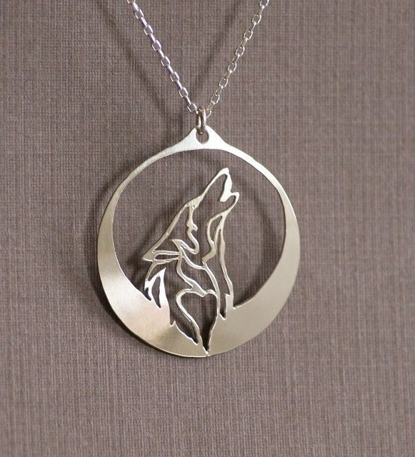 Lanseis. Howling Wolf Necklace and Pendant.  Wolf Howls Into The Night As It's Profile Is Captured In The Light Of A Silver Moon