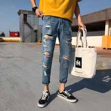 Spring new Hong Kong style denim nine pants men's hole youth leisure Harlan Korean version of the slim straight pants tide