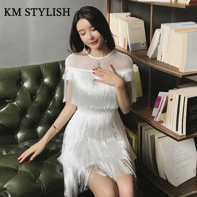 94340a77774 Thai tide Brand Cape-style Fairy Layer Tassel Stitching Slim Dress Hollow  Out Mesh Lace Stitching Fringed Champagne Dress White
