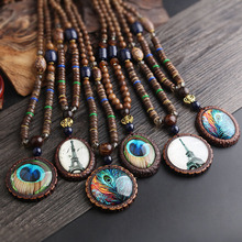 Long wooden bead decoration necklace creative peacock feather pendant ethnic wind sweater chain bohemian accessories pendant retro bead decorated feather tassel sweater chain necklace for women