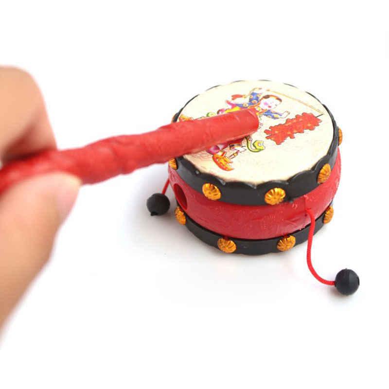 Encantadores Niños sonajero tambor instrumento Musical antiguo chino tradicional Lucky Boy and girl bended Handbell sonajero juguete para bebé