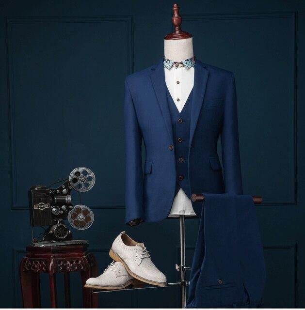 Traje azul (Pantalones de la chaqueta + Vest) 2017 Marca Moda Hombres Trajes de Chaqueta Delgada Azul Oscuro de Baile Vestido de Boda Del Novio Ropa de La Etapa Cantante