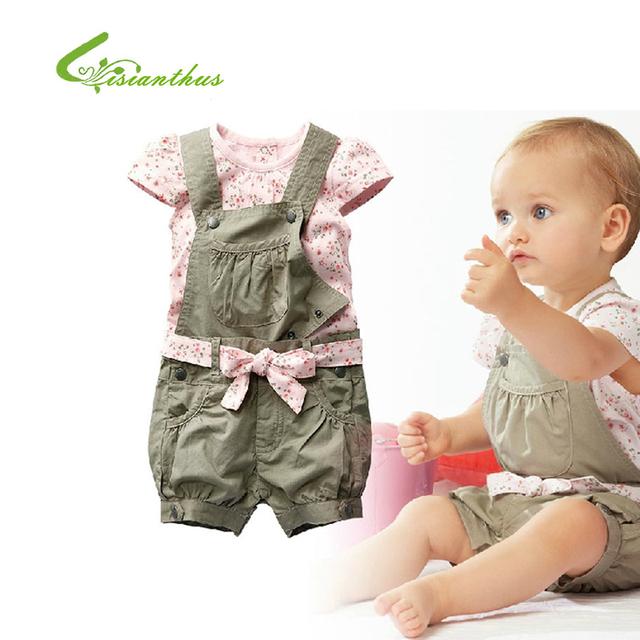 Ropa del algodón del bebé infantil de la muchacha a la moda Set niño lindo camiseta Floral del Bowknot de la pretina monos pantalones envío