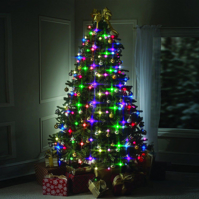 christmas tree with multicolored lights ...