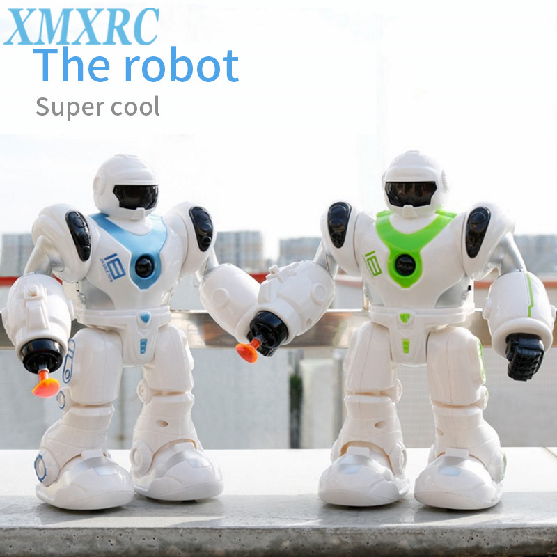 XMXRC.Launch the bullet 21 cm smart space dance robot electronic walking toy and music light astronaut toy childrens gift.