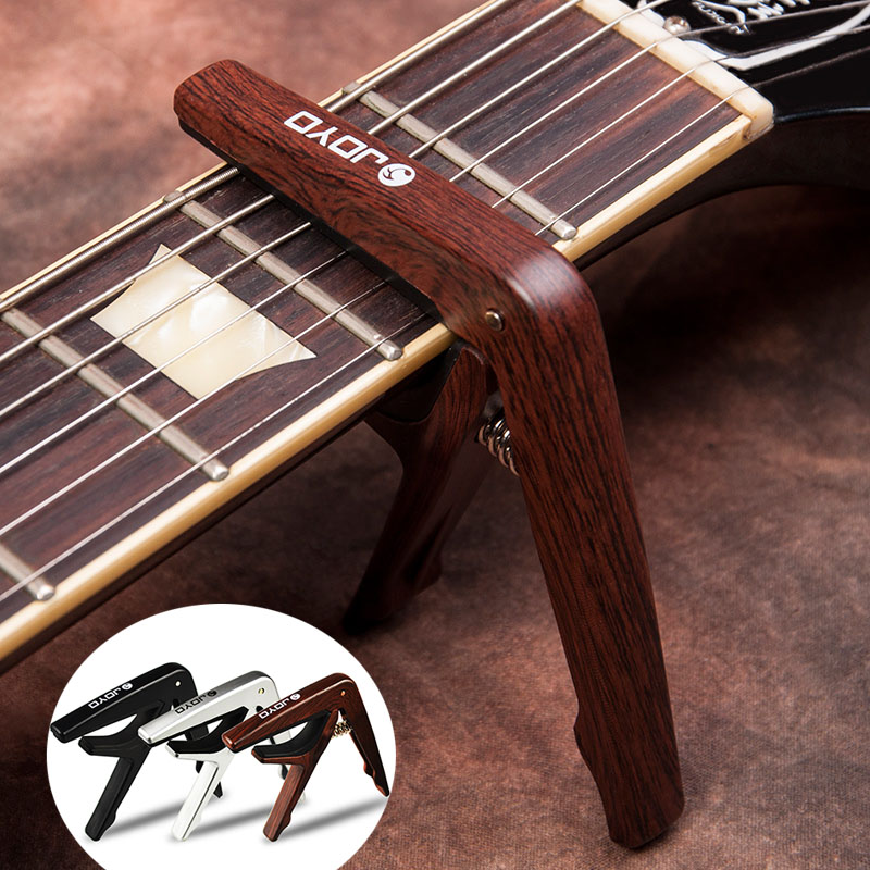 ABS Plastic Guitar Capo Clamp With Picks For 6 String Guitars Folk Pop Wood Guitar Ukulele Parts & Accessories JOYO JCP-01 Capos