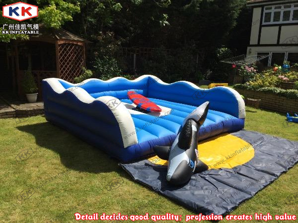 Children Birthday Party playing game inflatable rodeo surfboard ride