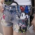 Hot 2017 Pantalones Cortos de Verano Las Mujeres estilo Coreano pantalones vaqueros Del Club Moldeado Sequinsed Ripped Shorts patrón de Dibujos Animados de bolsillo Pantalones Cortos de Mezclilla Sexy