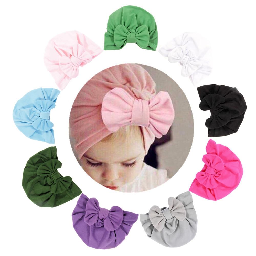 Nishine 10 Colors Newborn Baby Bowknot Soft Cotton Blend Hat Caps Knot Bow Kids Turban Hats Fashion Baby Caps