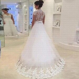 Image 2 - 2019 החדש V צוואר קצר שרוול קשת חגורת כפתור אונליין שמלת כלה באיכות הכלה חתונת שמלת Vestido דה Noiva