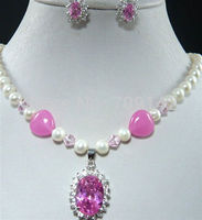 Woman rock mascot the pearl powder red gem stone and locket pendant earring of white