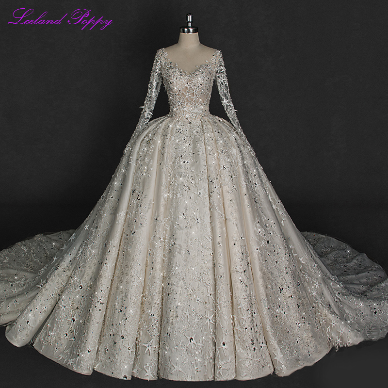 Luxury Ball Gown Lace Wedding Dresses 2020 V-neck Sparkly Crystal Beaded Long Sleeves Backless Bridal Gowns Cathedral Train
