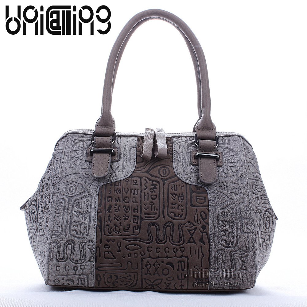 Luxury leather women tote bag fashion brand vintage ancient hieroglyphic embossing women genuine leather handbag fashion handbag ladylike women s tote bag with solid color and daisy embossing design