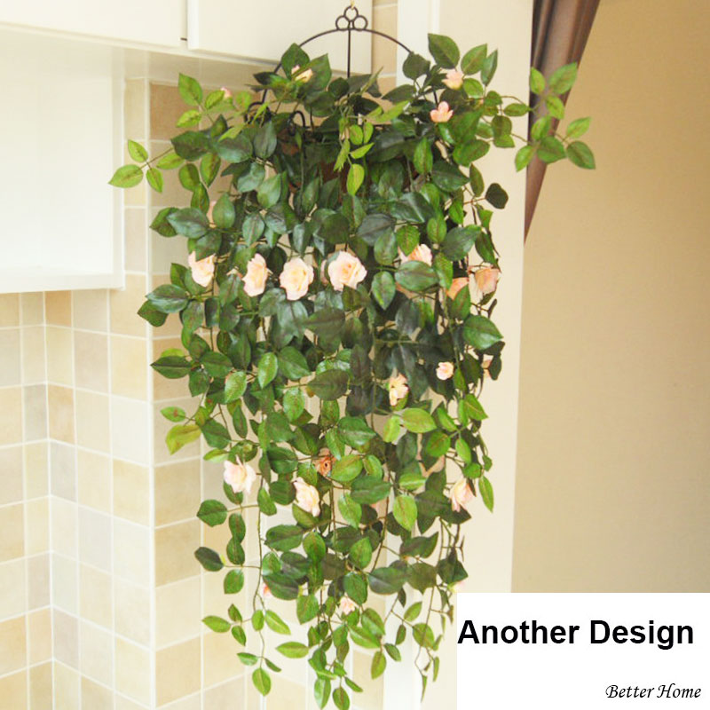 artificial green plants with flowers with iron baskets hanging