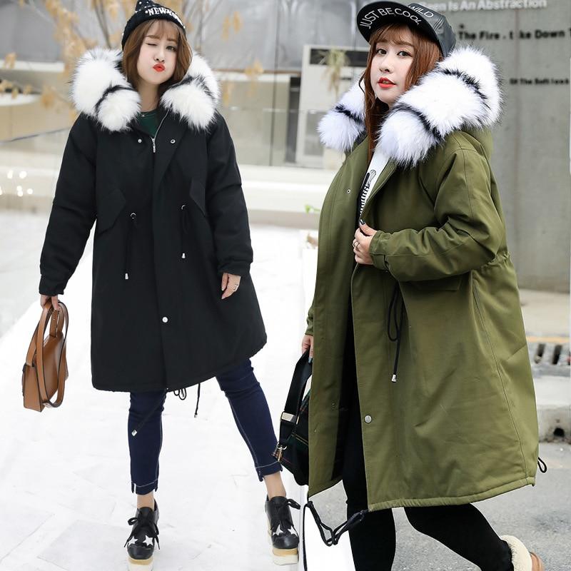 Haute qualité longue à capuche parkas femmes épais chaud fourrure de raton laveur artificielle grande taille mode femme pardessus grande poche