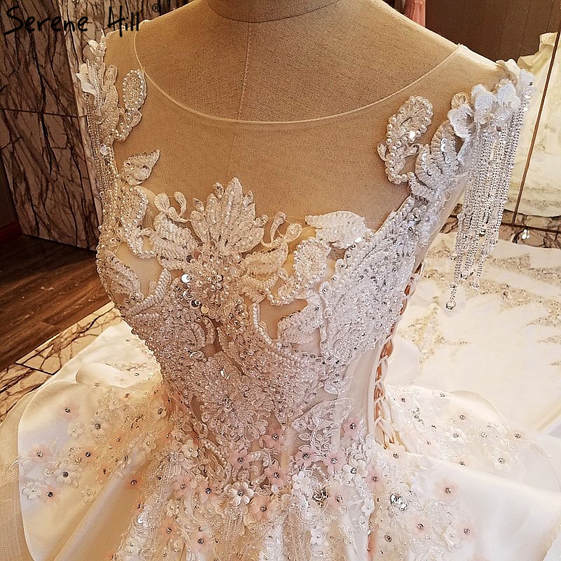 Luxury Diamond Pearls Lace Train Wedding Dresses High end Sleeveless Sexy  Princess Bridal Dress 2018 Vestido De Noiva -in Wedding Dresses from  Weddings ... b3bb322b78eb