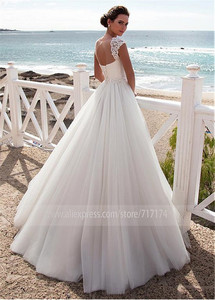 Image 2 - Stunning Tulle Jewel Neckline A Line Beach Wedding Dress With Beaded Lace Appliques Crystals Belt Bridal Gowns