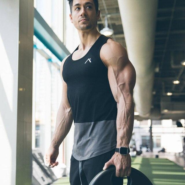 Mens academias de fitness musculação Regatas Stringer Undershirt colete de  algodão Slim fit Camisas sem mangas ec73503e190