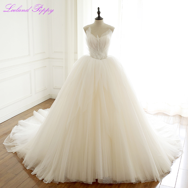 Elegant A-line V-neck Tulle Wedding Dresses Crystal Beaded Sleeveless Corset Back Ruched Bridal Gowns Chapel Train Empire Waist