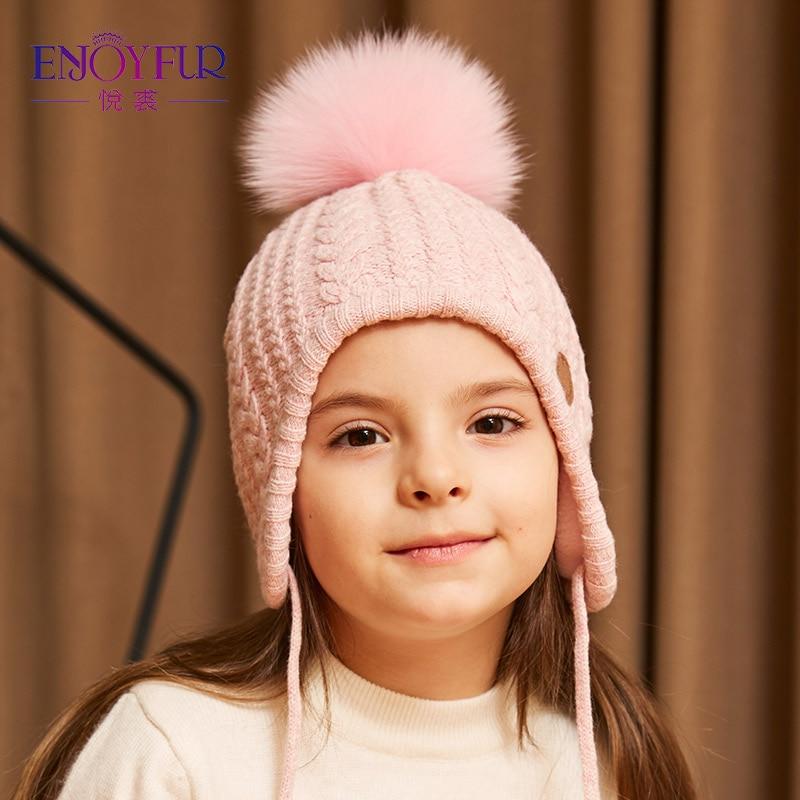 Aliexpress.com  Comprar ENJOYFUR niños Caps grueso invierno cálido Caps  para bebé Fox Fur Pom buena calidad caliente edad 2 8 niños Niñas oídos  sombrero ... b2dd4406d4a