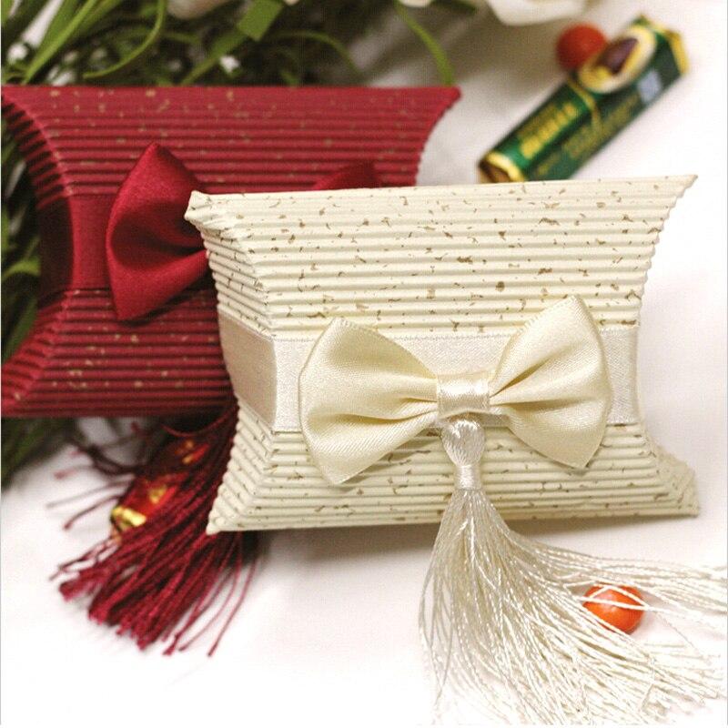 100 pcs/lot 2 couleur oreiller arc boîte à bonbons avec des glands pour mariage bonbons faveur cadeau événement fête fournitures