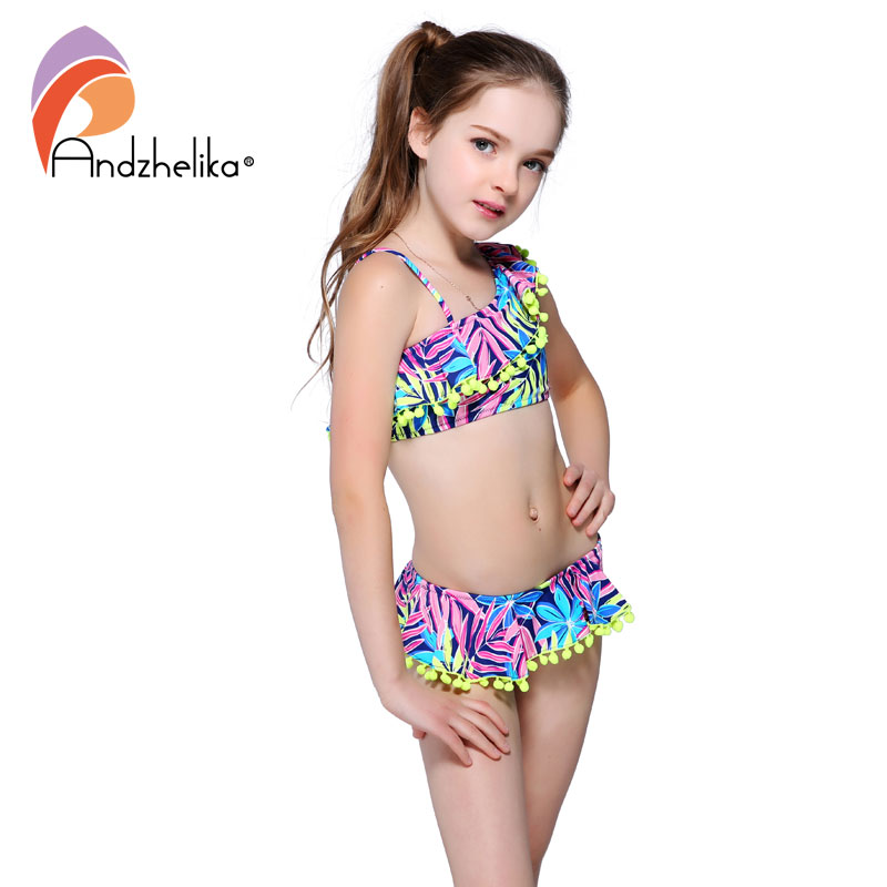 все цены на Andzhelika Bikini Children's Swimwear Ball Cute Lotus Leaf Dress Swimwear Two Piece Kid One Shoulder Swimsuit Girls Bathing Suit