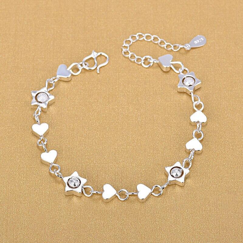 Купить женский браслет из серебра 925 пробы с шармами в виде сердца