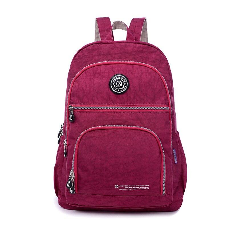 все цены на JINQIAOER Brand Nylon Backpack Waterproof Women Knapsack Drawstring String Backpack Girl Student School Bag For Laptop Mochilas онлайн