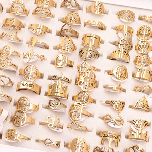 Image 4 - 50Pcs/lot Mix Random Style Laser Cut Pattern Golden Color Stainless Steel Rings Women Party Ring