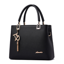 купить 2019 Spring New Fashion Embossed Handbag Korean Version Of The Tassel Pendant Shoulder Bag High Quality Messenger Bag по цене 1451.96 рублей