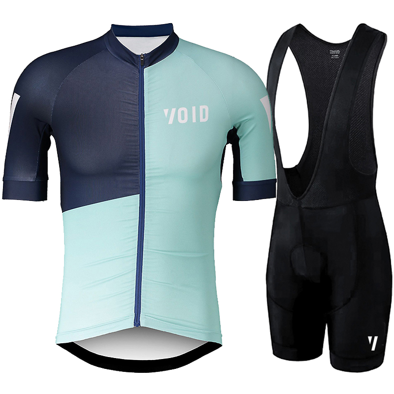 Green with blue cycling jersey and black pants