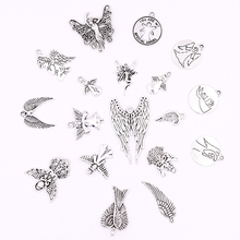 цена All 10pcs Silver Metal Angel Wings Charms Pendants for Jewelry Making DIY Crafts Charm for Bracelets Earrings Necklaces Making онлайн в 2017 году