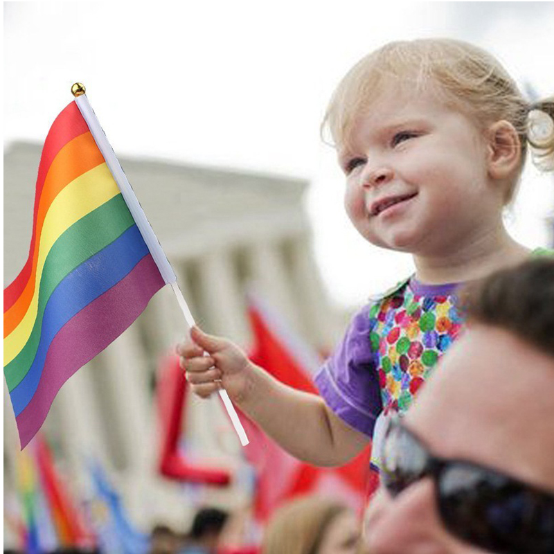 Rainbow Hand Waving Flags Lesbian Gay Pride Celebration Parade Party LGBT