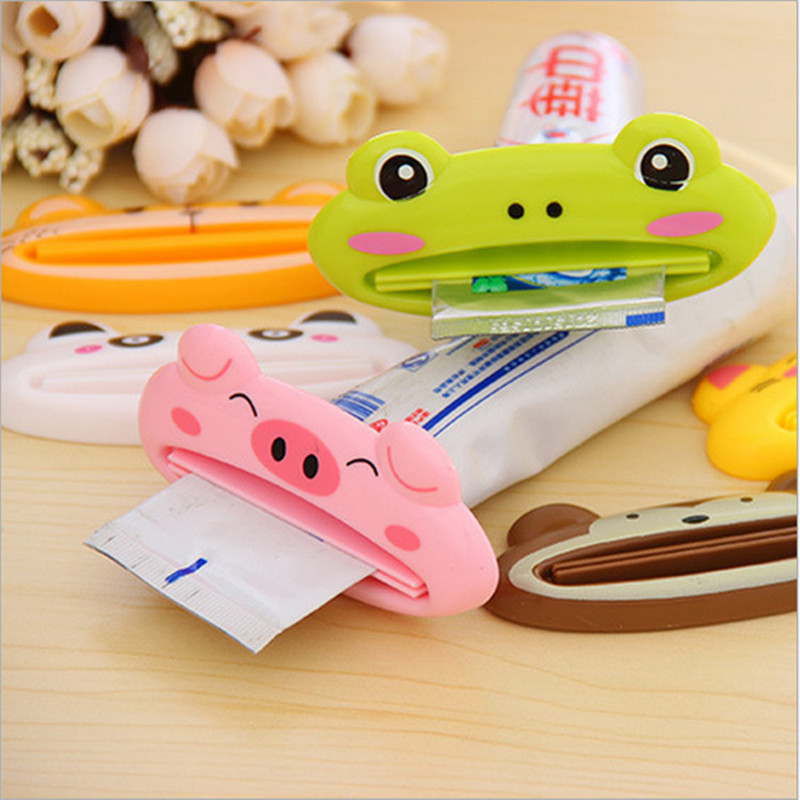 1pc 9cm*4 cm Cute Animal Bathroom multifunction Squeezer Home Tube Rolling Holder Cartoon Toothpaste Dispenser Free Shipping